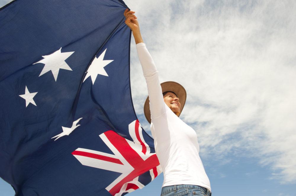 refugee holding flag